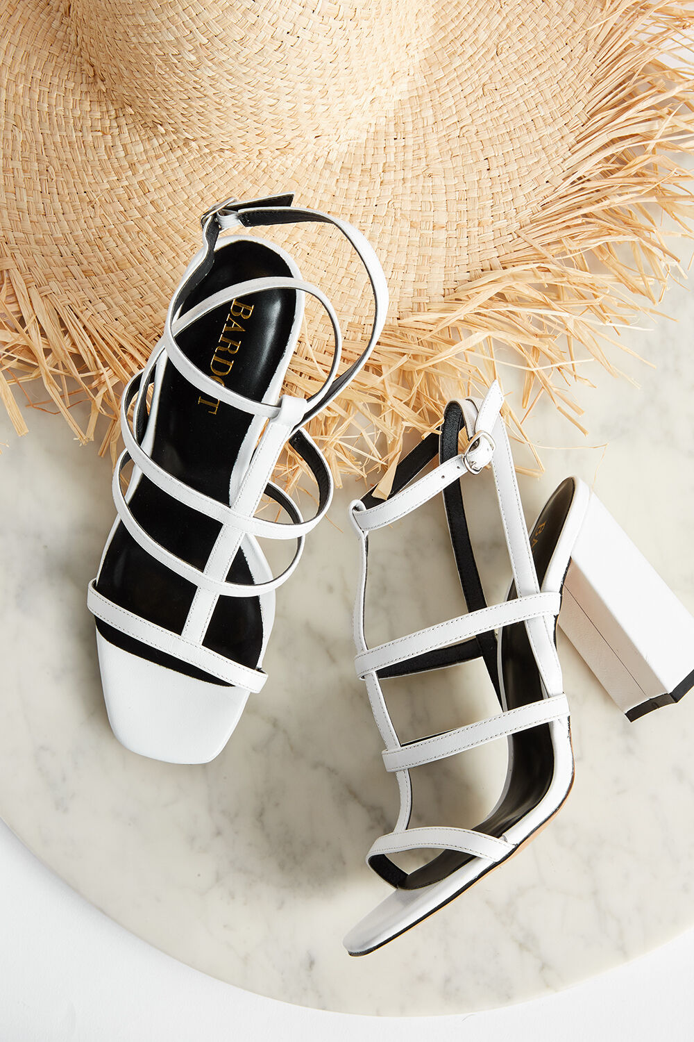 CAGED LEATHER  STRAP HEEL in colour CLOUD DANCER