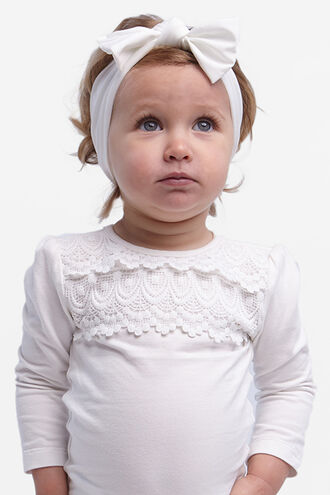 BABY STRETCH HEADBAND in colour WHITE ALYSSUM