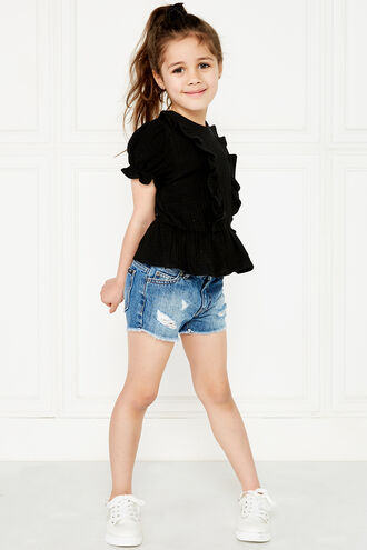 PIA RUFFLE TOP. in colour JET BLACK